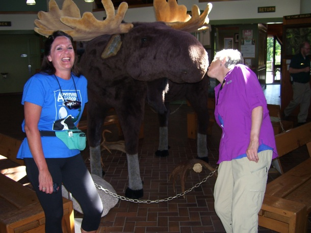 Cindy kissing a moose goodbye